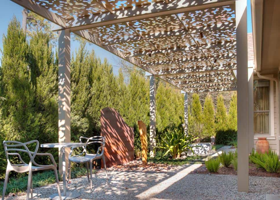 Patio under aluminum arbor by Exterior Worlds Landscaping