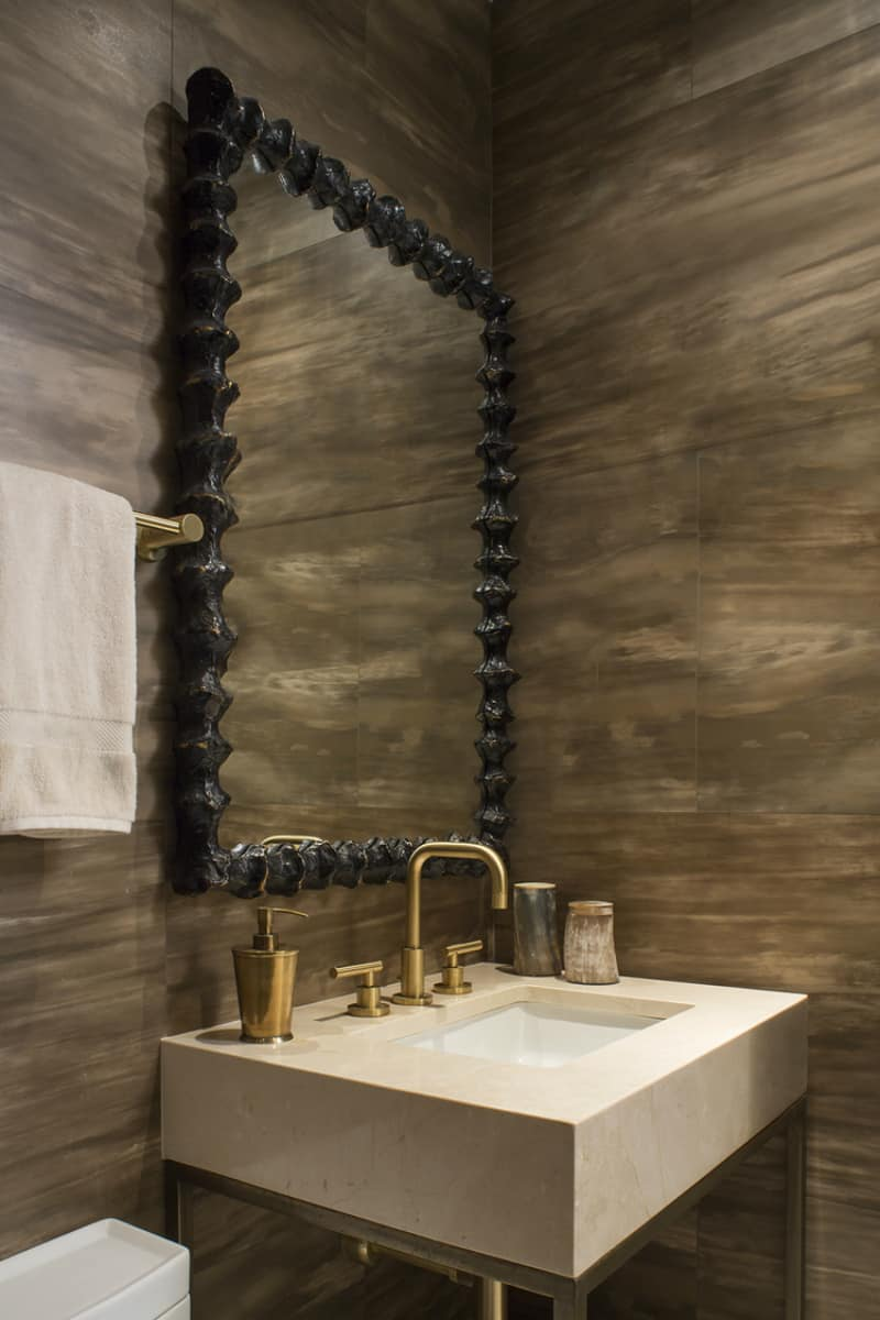 Powder room in wood look tiles by Wendy Labrum