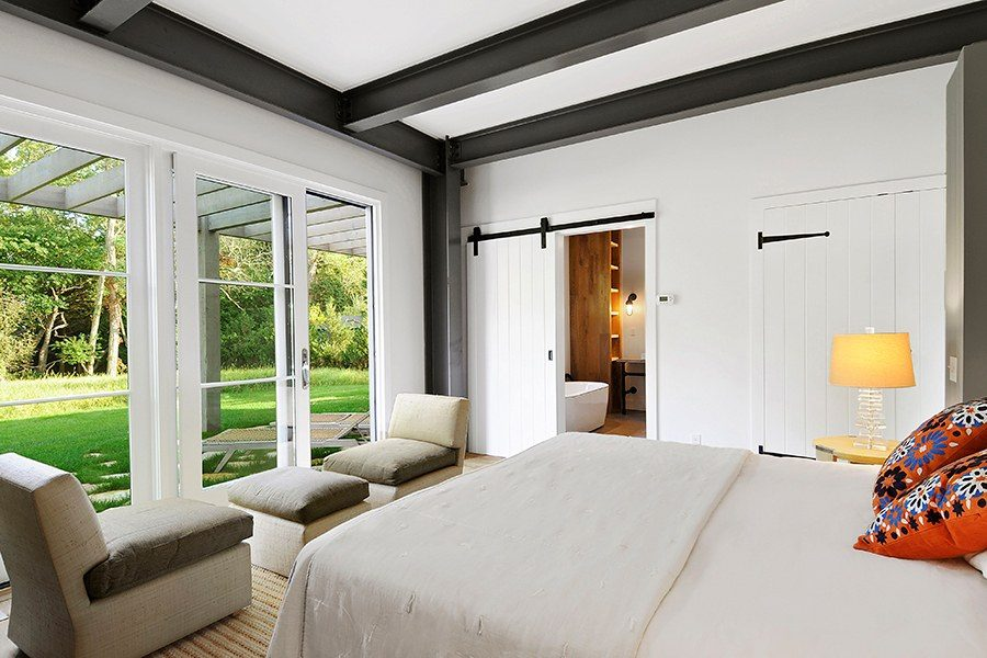 Retreat bedroom with bathroom barn doors