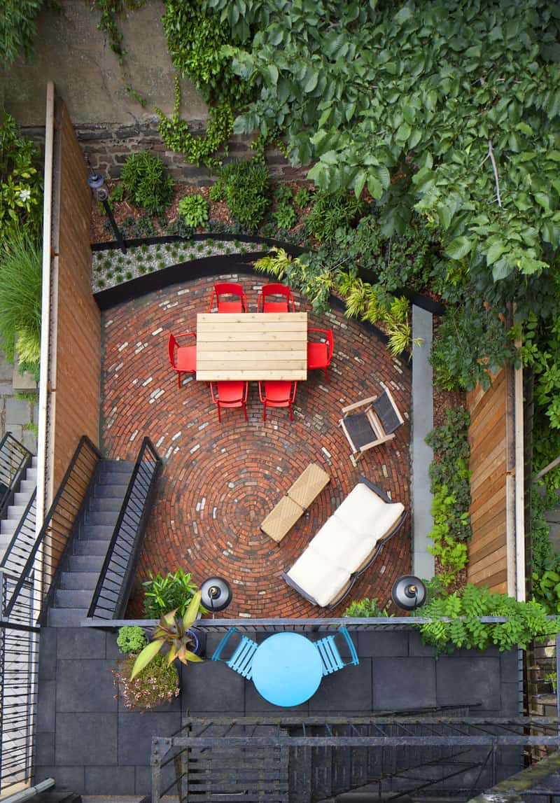 Small backyard by New Eco Landscape Design & Build