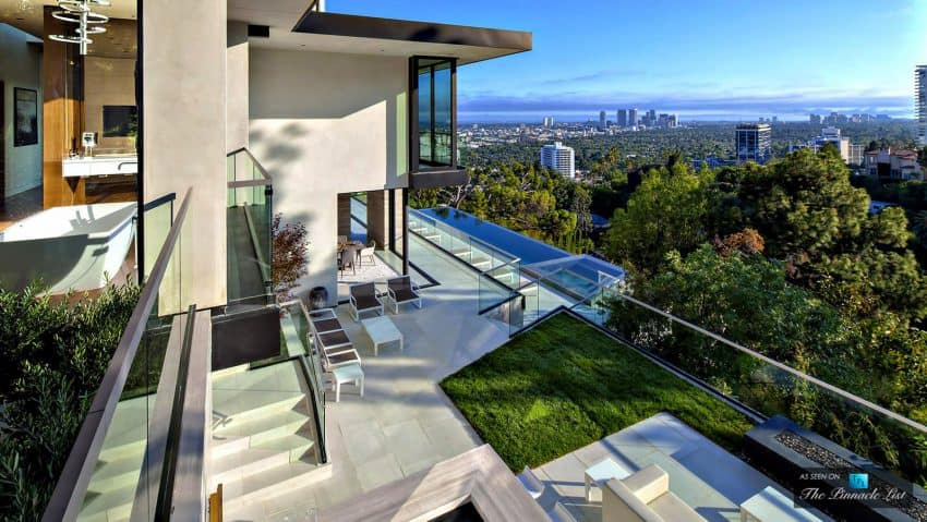 Stone and glass deck is so big it houses a green lawn