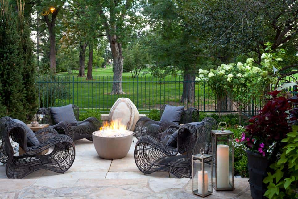 Stone patio with statement chairs