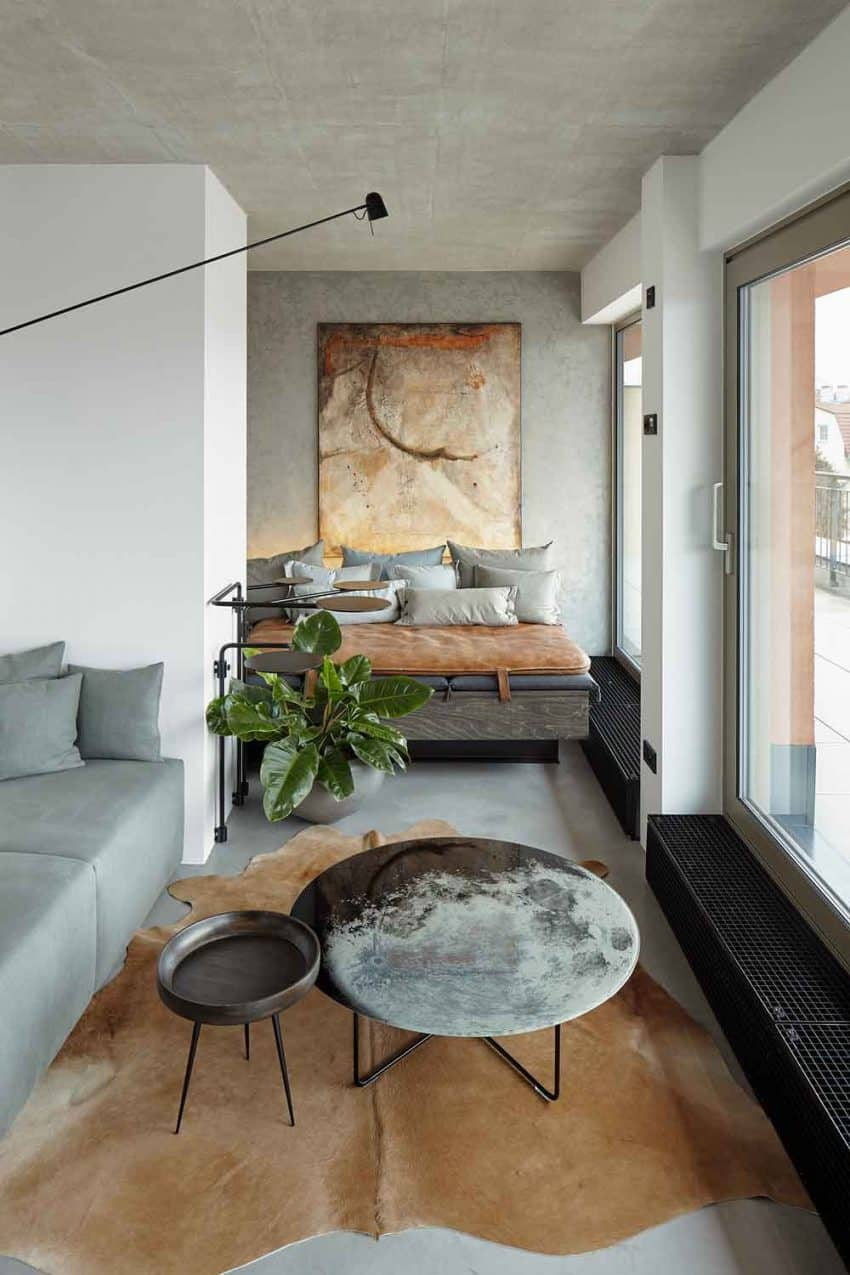 The living room coffee table looks like a moon This Prague Loft Is Everything an Urban Dweller Could Dream Of