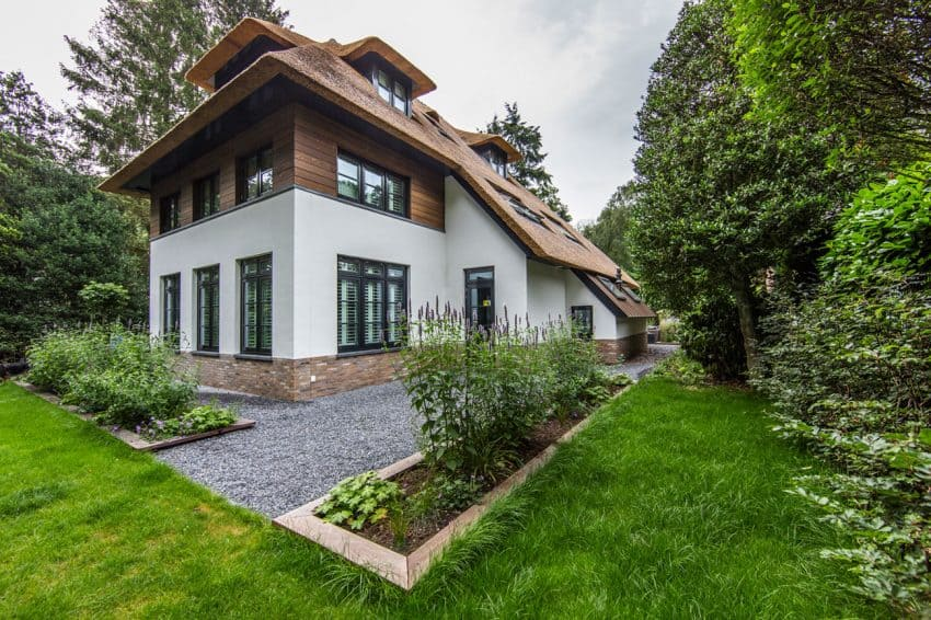 Villa extensions hide under a traditional sloping roof