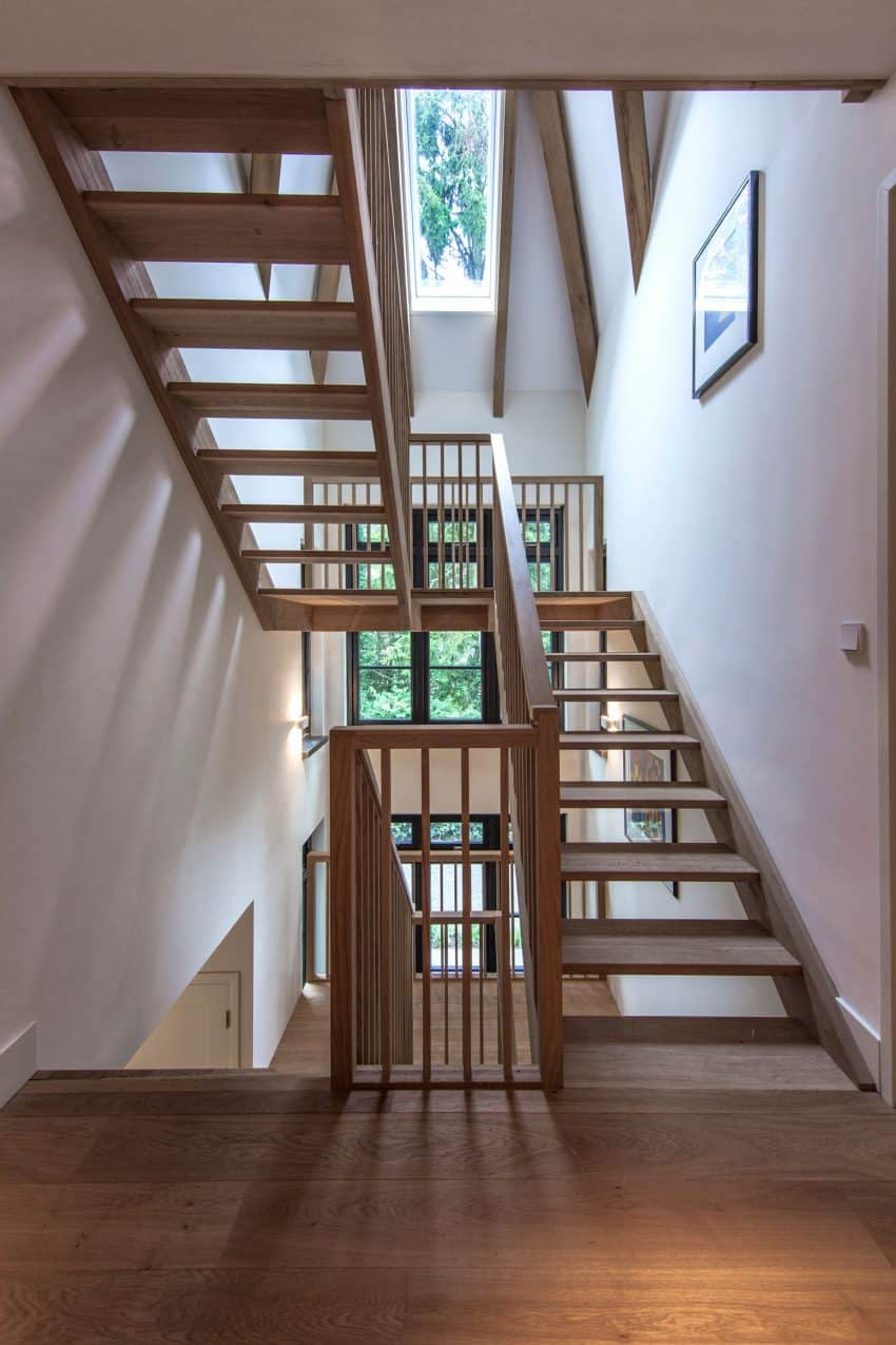 Wooden staircase plays nicely along wooden beams and flooring
