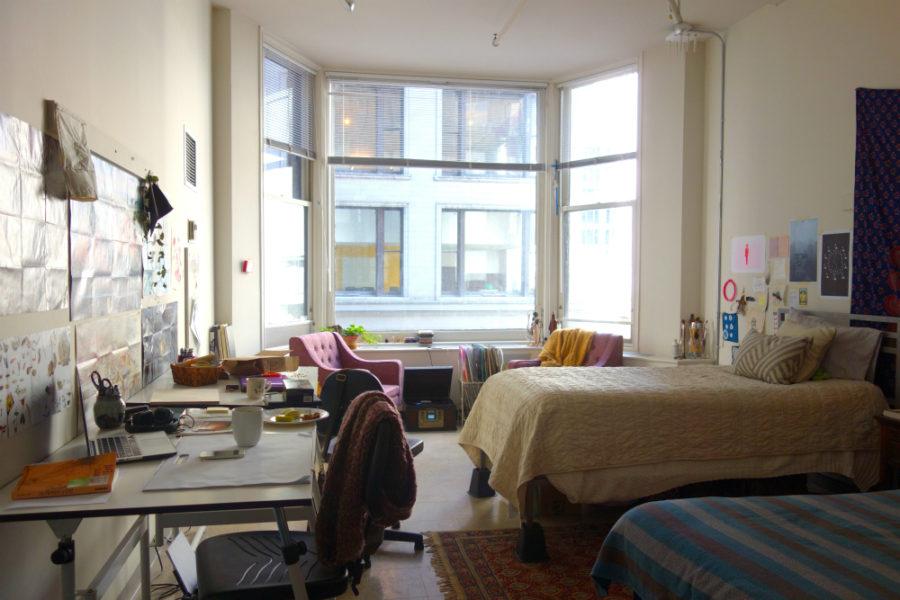 Artsy modern dorm room with a huge bay window