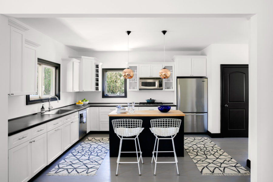 Black and white kitchen flaunts trendy accents