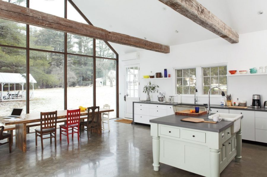 Concrete floor kitchen design with wooden beams
