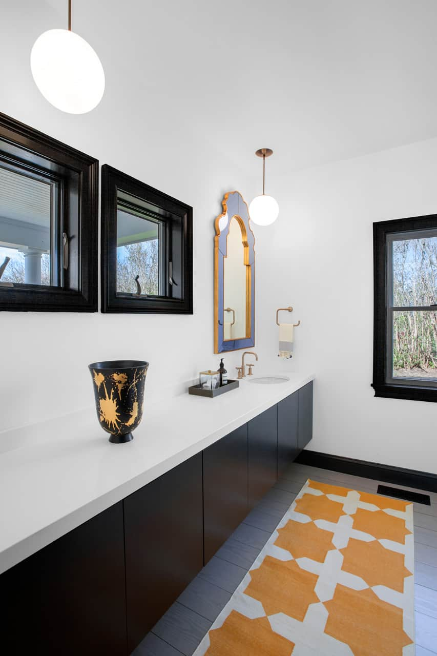 elongated-bath-vanity-makes-for-a-clean-look-allowing-offering-of-storage-space