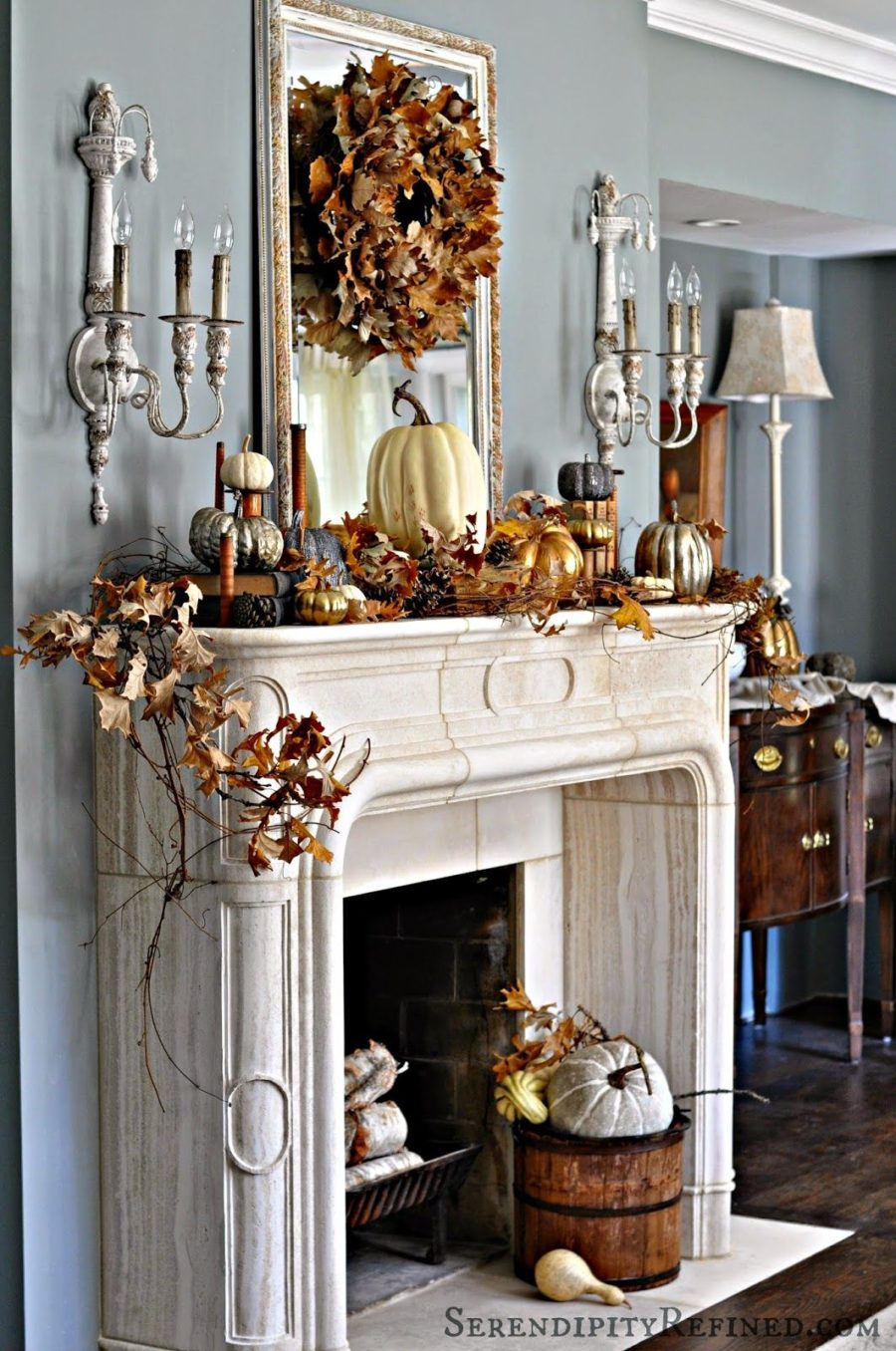 Fall decorated white fireplace 900x1356 15 Fall Decor Ideas for your Fireplace Mantle