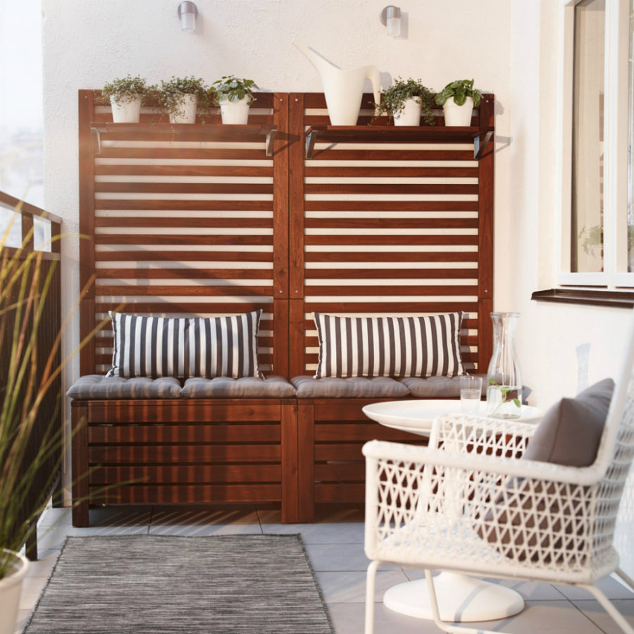 IKEA bench storage and white armchair