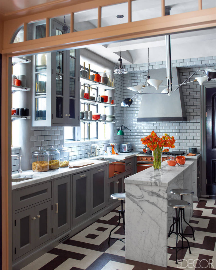 View in gallery Industrial grey kitchen with orange accents