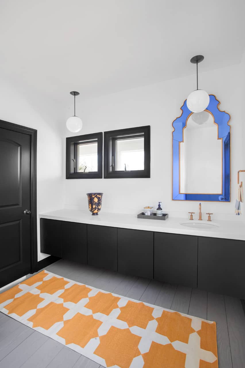 Keeping the black on white color palette throughout the house designers allow bright accents to stand out
