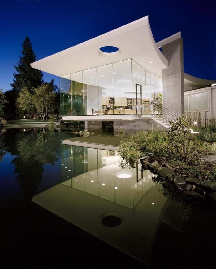 Lakeside studio with a glass wall facade