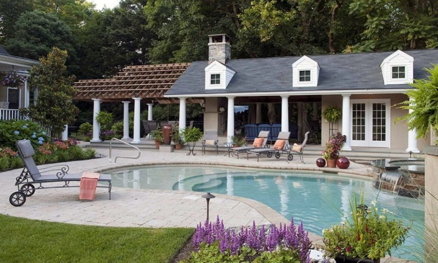 Large traditional pool house with cozy accents