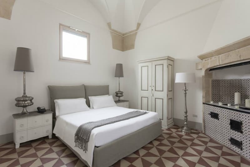 Lecce guest house bedroom with tiled floors