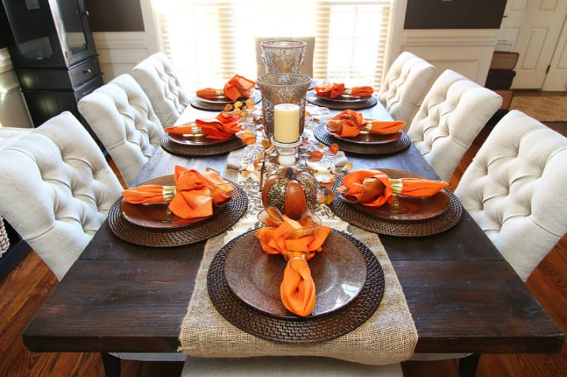 Orange napkins as accents in fall dining table decor
