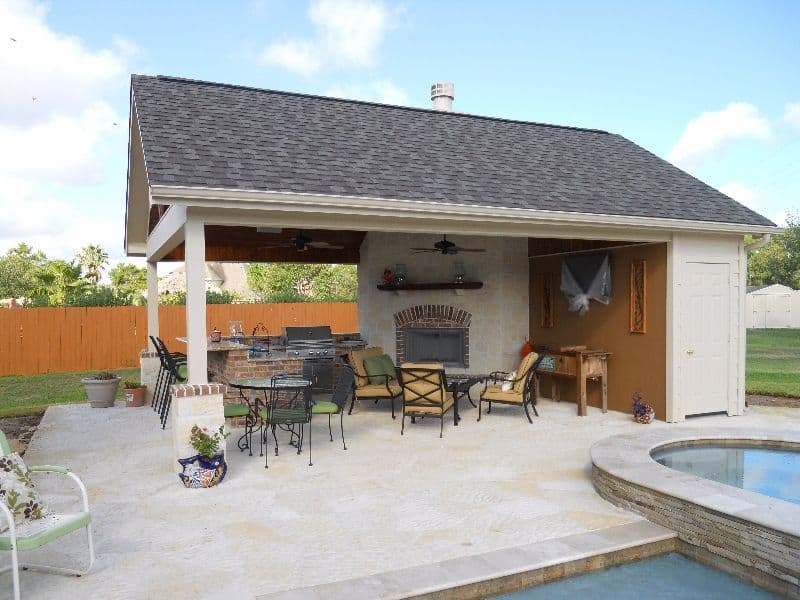 Outdoor kitchen area with pool