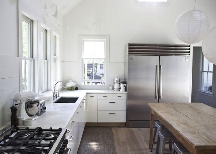 Reclaimed wood floor in a farmhouse kitchen