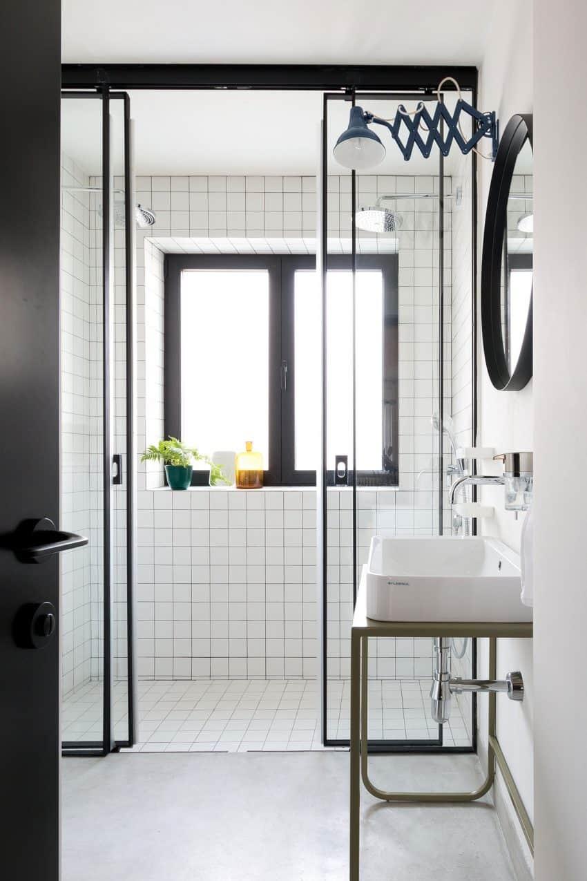 Simple bathroom design surprises with sliding shower doors