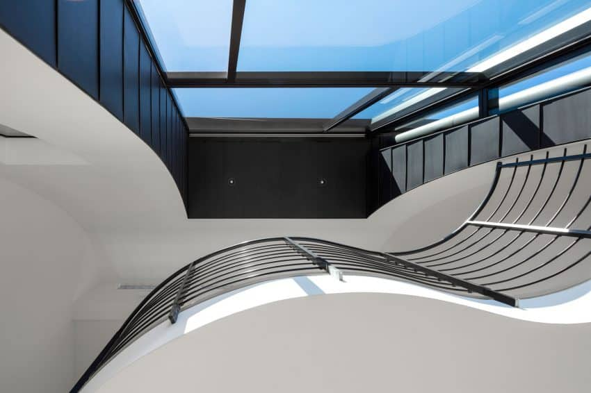Air between a mezzanine and the window create a pocket of open space