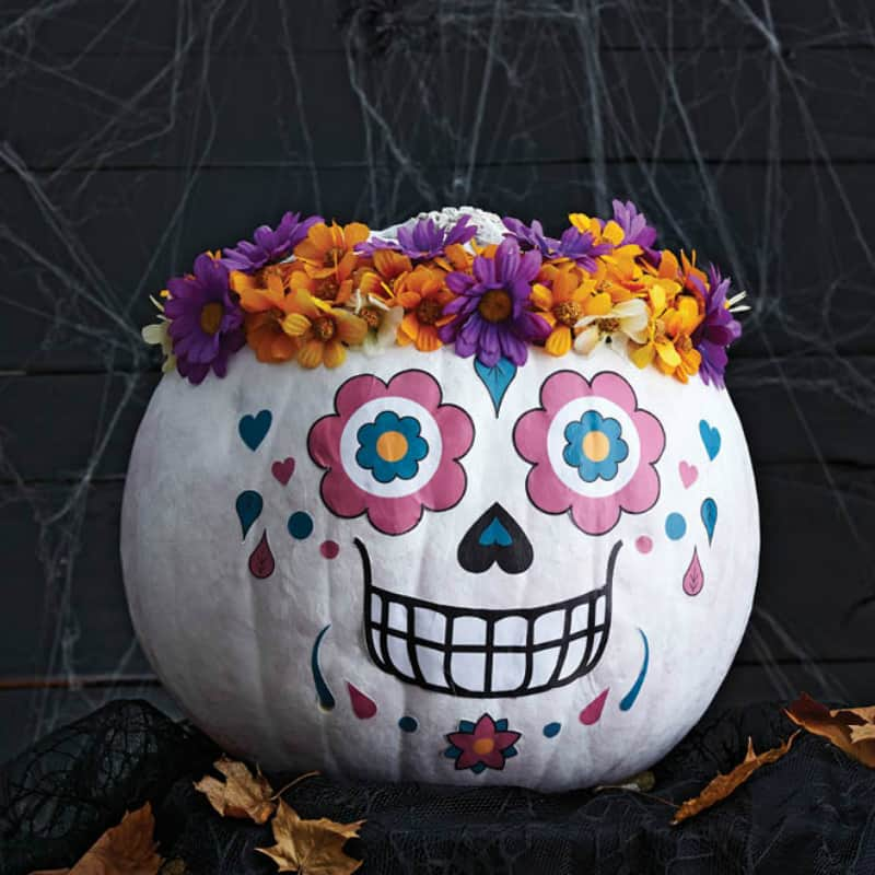 Sugar skull pumpkin with a floral wreath
