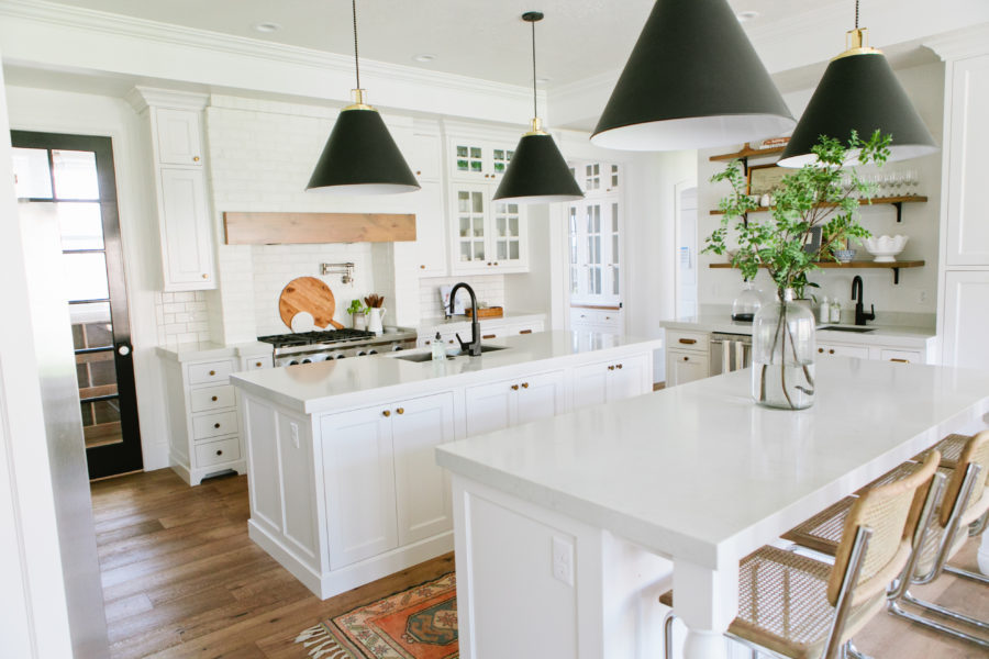 White charming farm kitchen with two islands
