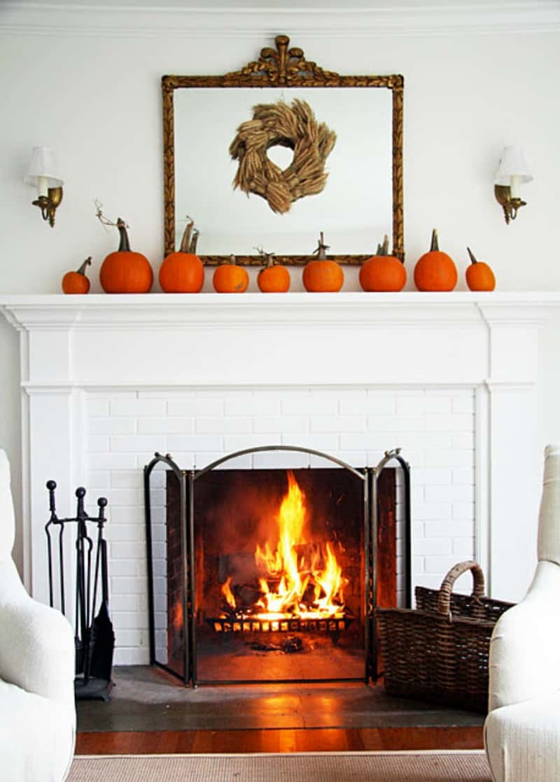 white-fireplace-decorated-with-pumpkins