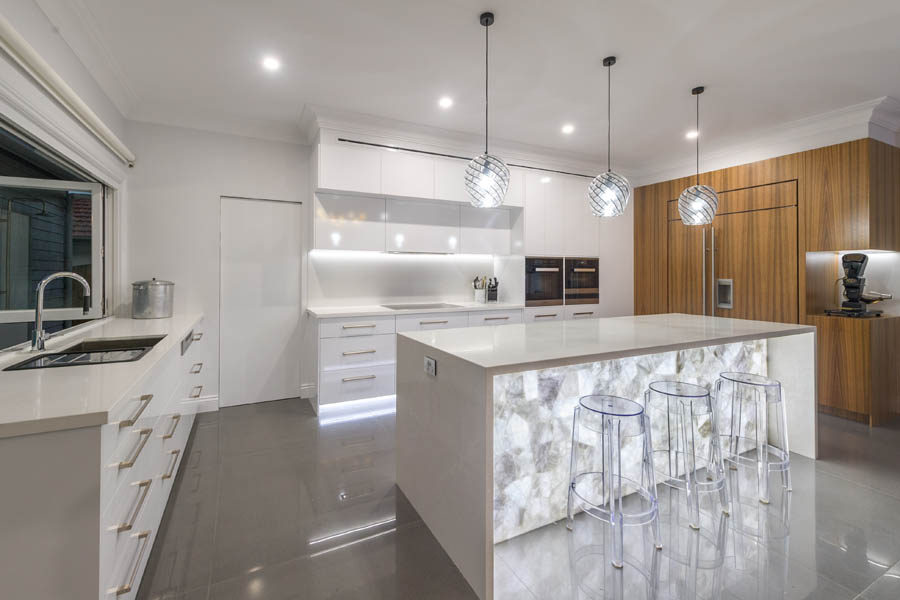 White quartz backlit kitchen island