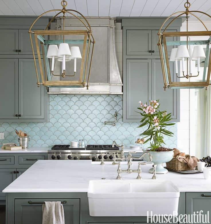 coastal-style-kitchen-with-large-latern-like-lights-and-carrara-marble-counter-tops