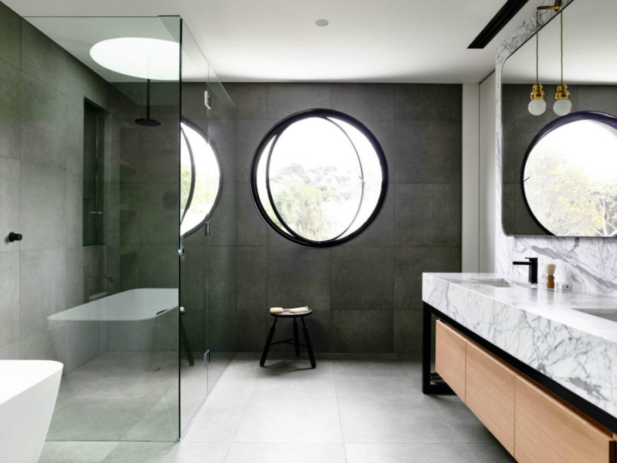 Bathroom has a cool round window