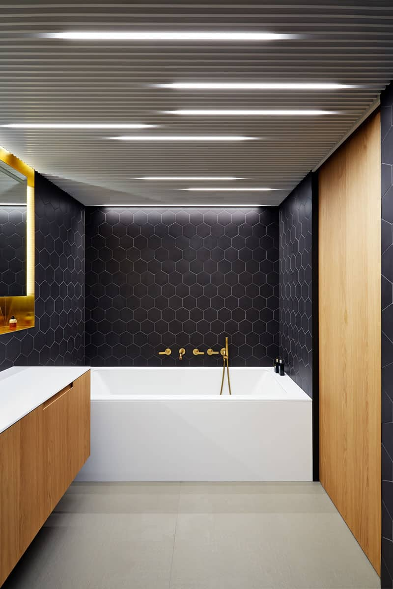 View In Gallery Black, Brass, And Wood Bath