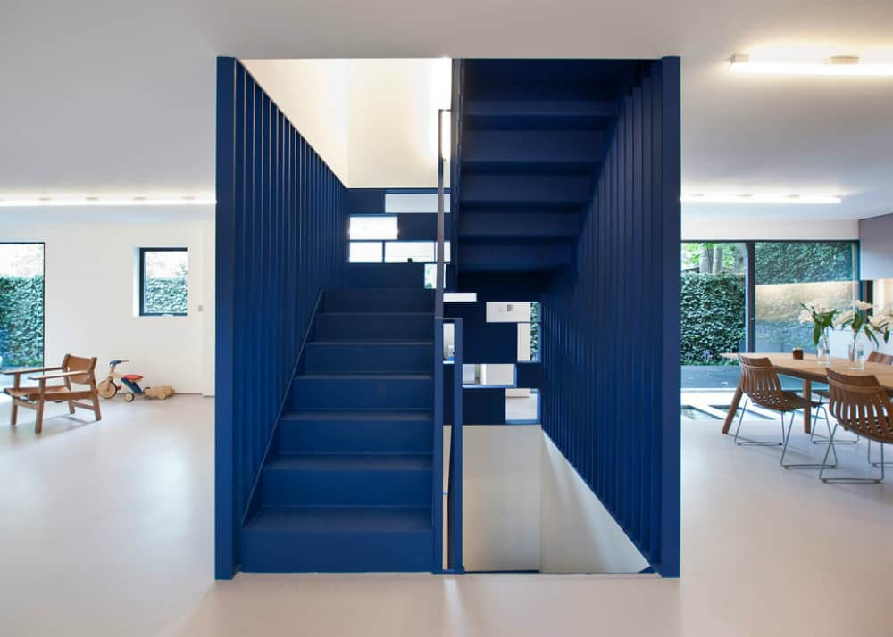 Blue steel staircase with a bookcase