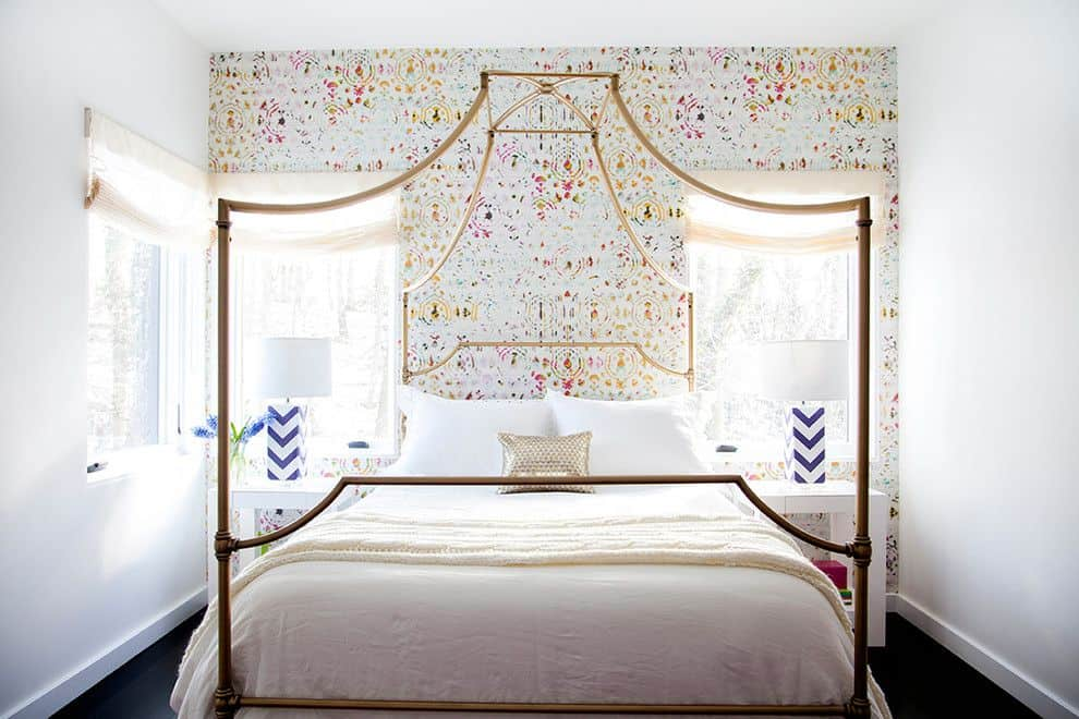 Colorful bedroom wallpaper and canopy bed