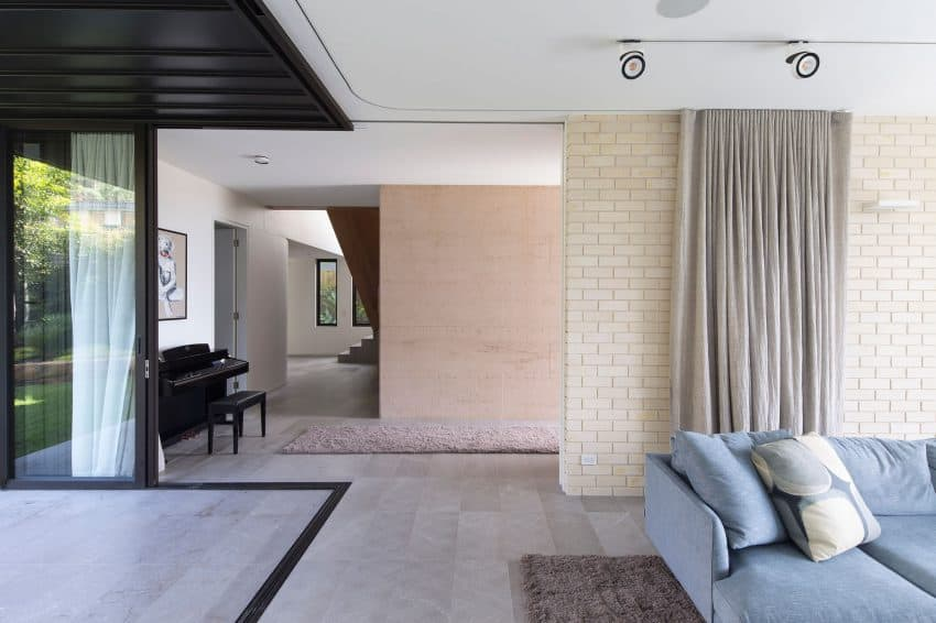 Curtains divide partially open interior spaces