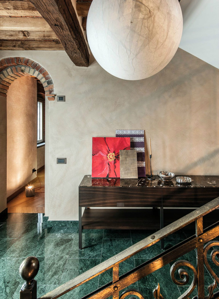 Foyer floors are covered with green marble tiles
