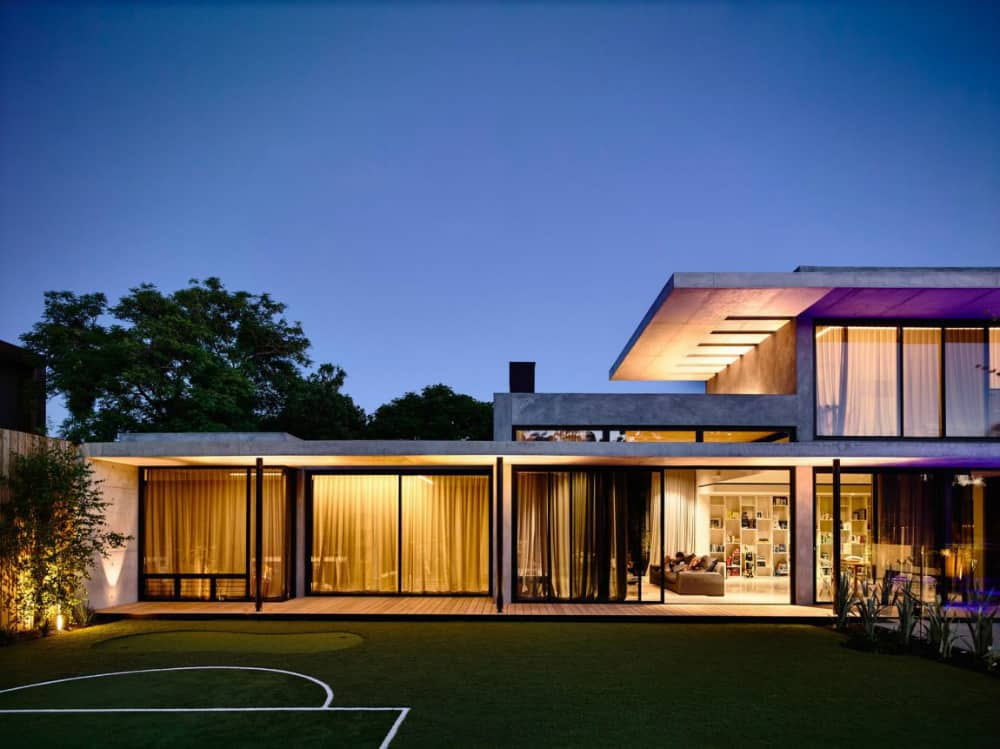 Glass-heavy house design is protected by numerous curtains