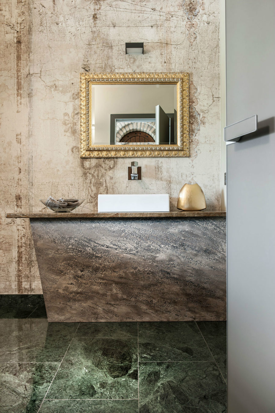Golden accents work well with the textured stone surfaces