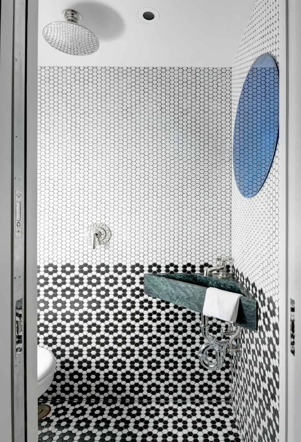 Hexagonal tiles in powder room design