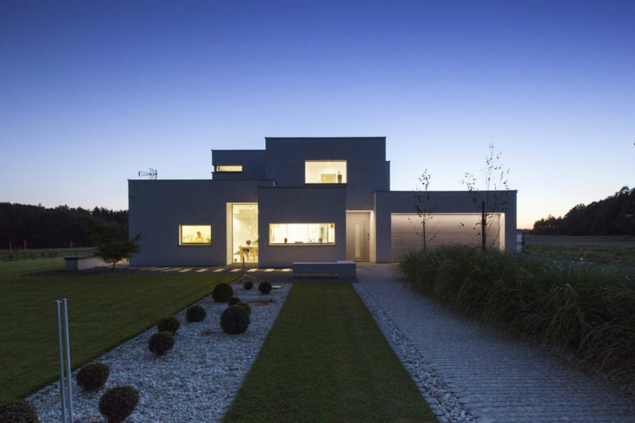 House's rectangular windows light up at night