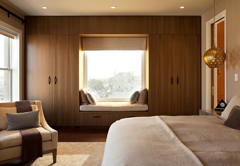 Mahogany window seat and bedroom closet