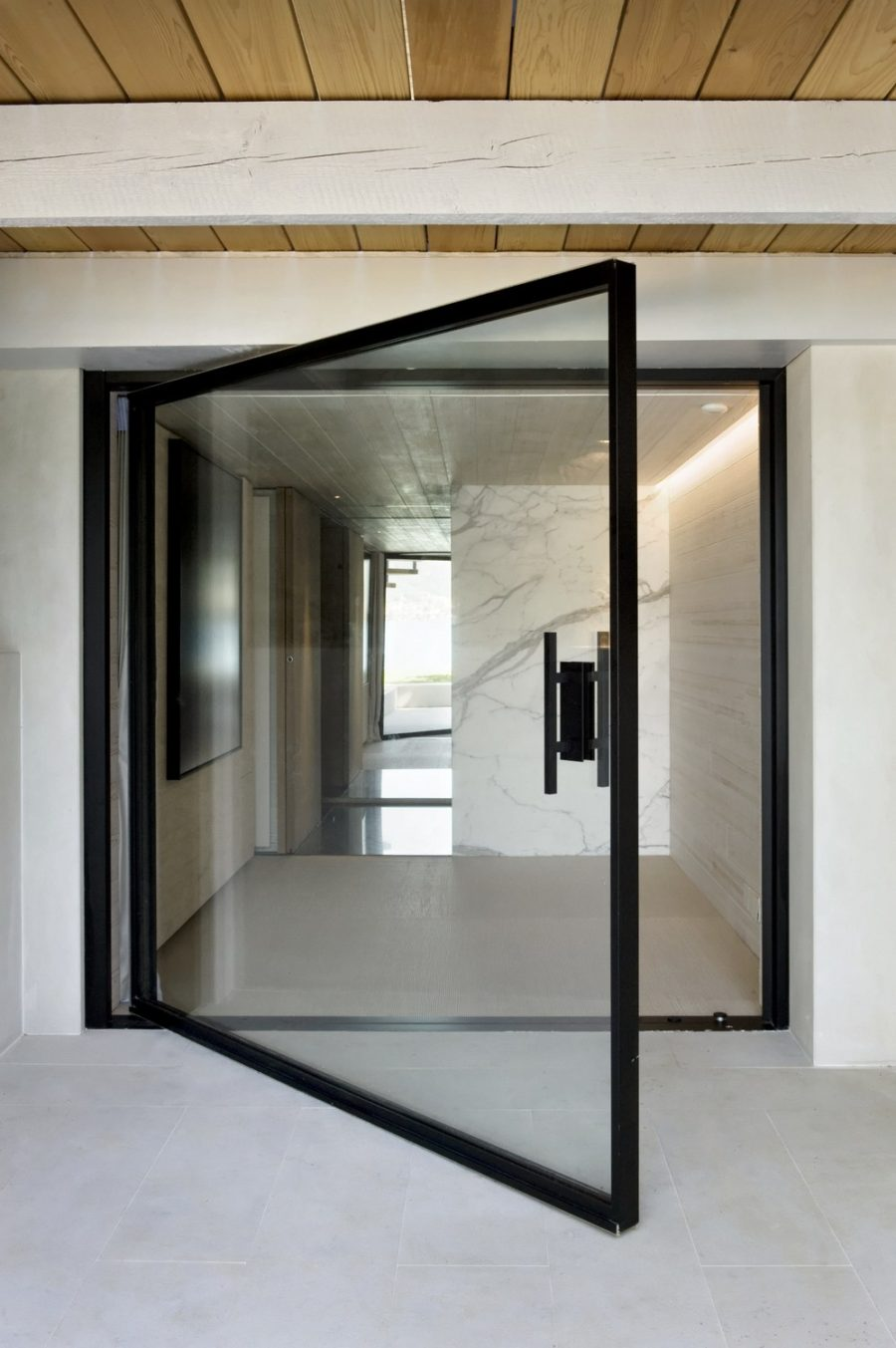 Pivoting glass door