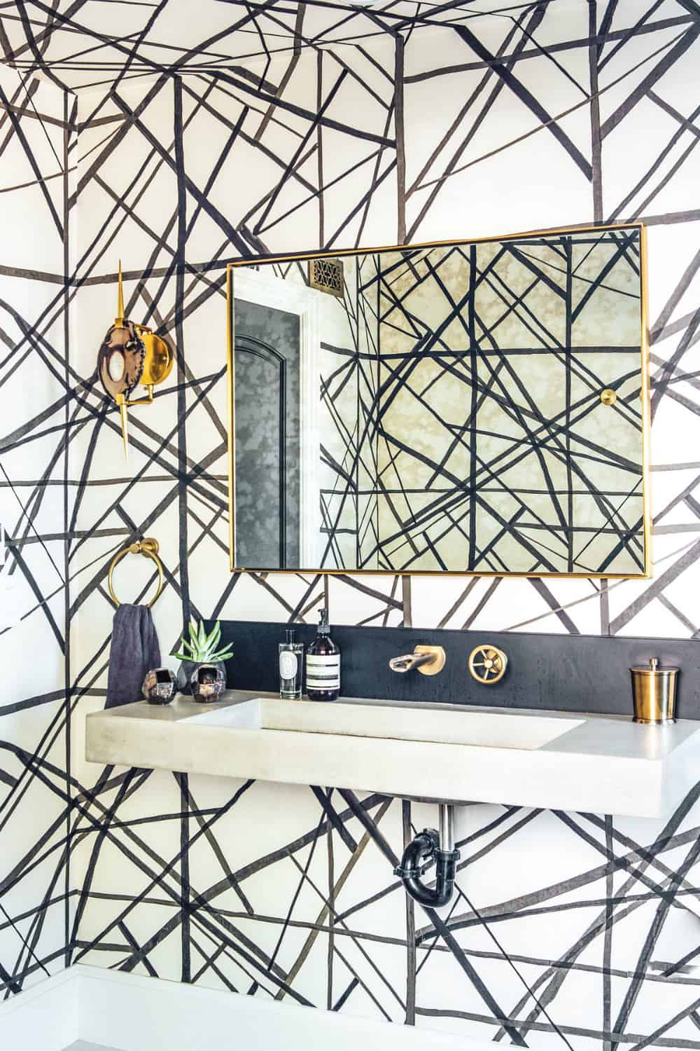 Powder room with graphic wallpaper
