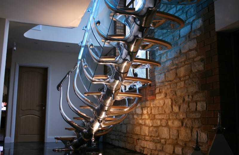 Sculptural staircase with glass and timber details
