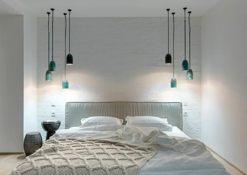 Second bedroom with turquoise pendant lights