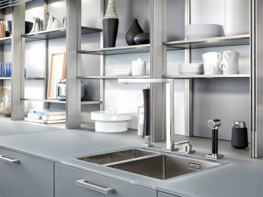 ... Sleek Sink Features A Thick Glass Countertop For Splashes