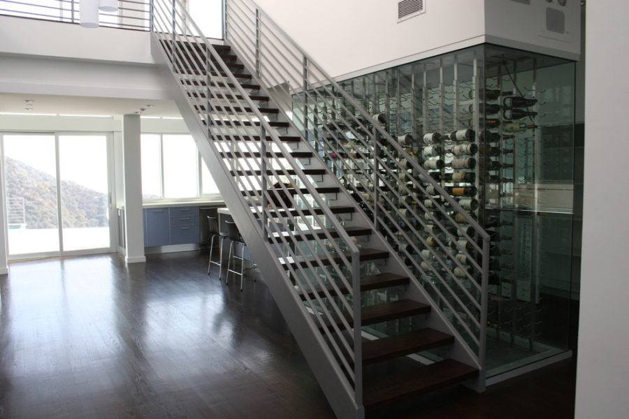 Staircase wall glass-enclosed wine cellar