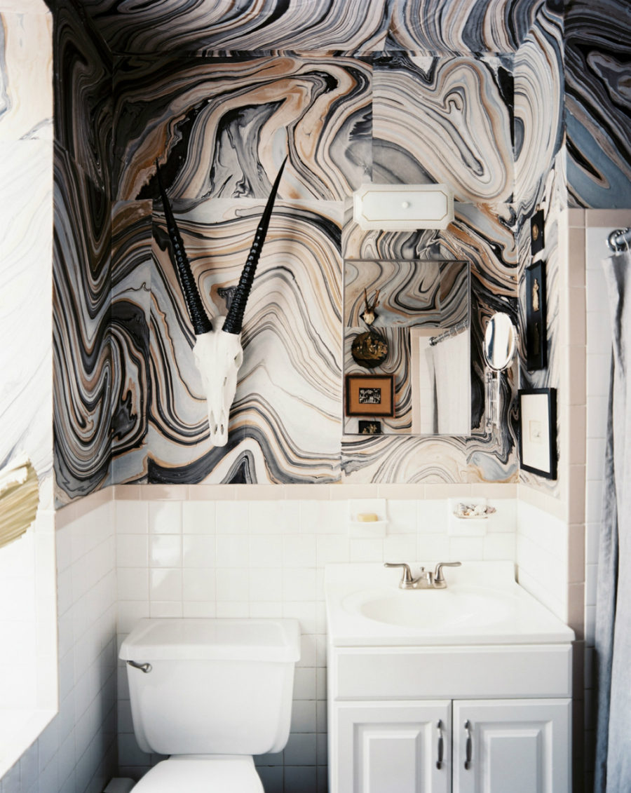 Stone-like wallpaper feature wall in a powder room