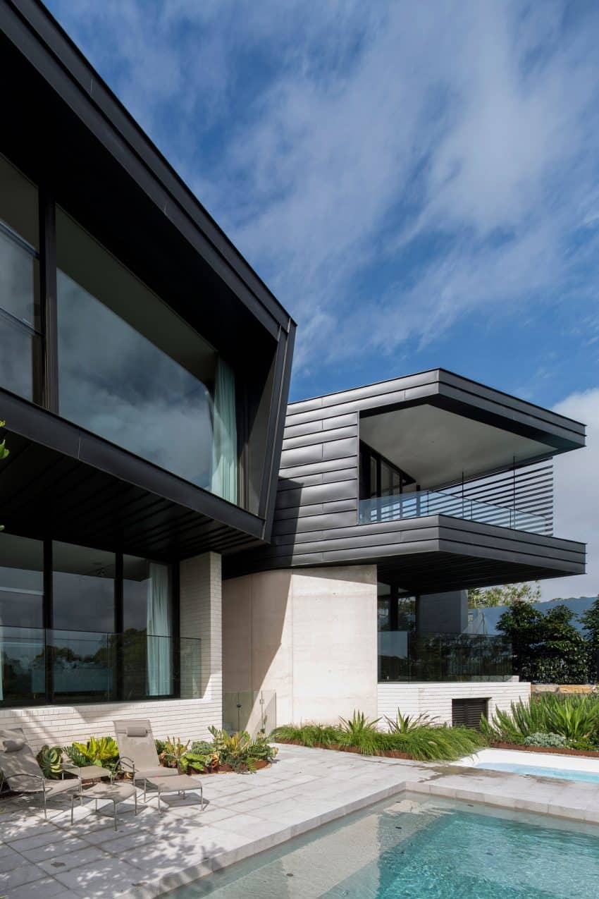 Swimming pool extends to the entry space Contemporary Balmoral House in Green Australian Paradise