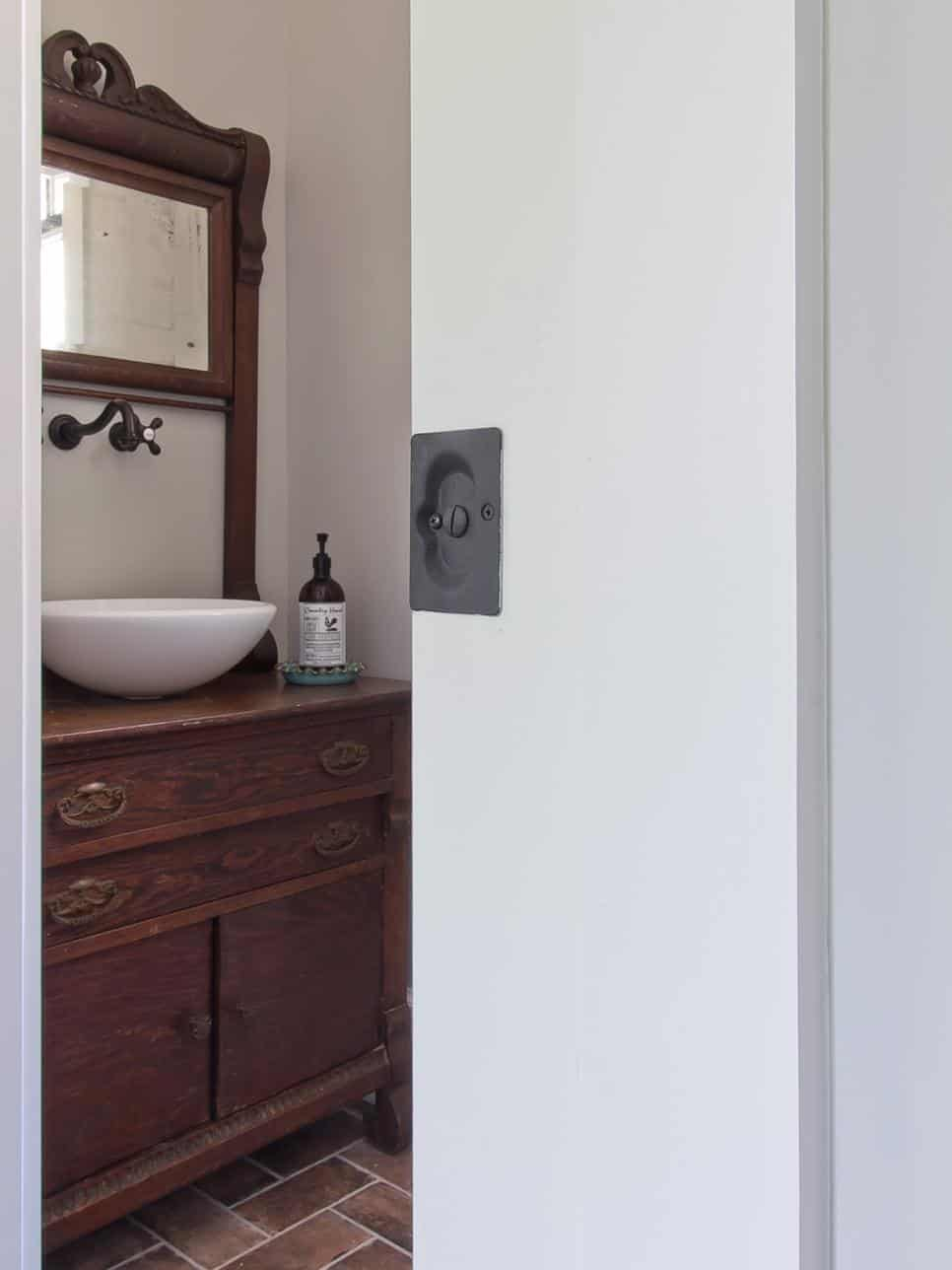 Vintage powder room by New River Building Co